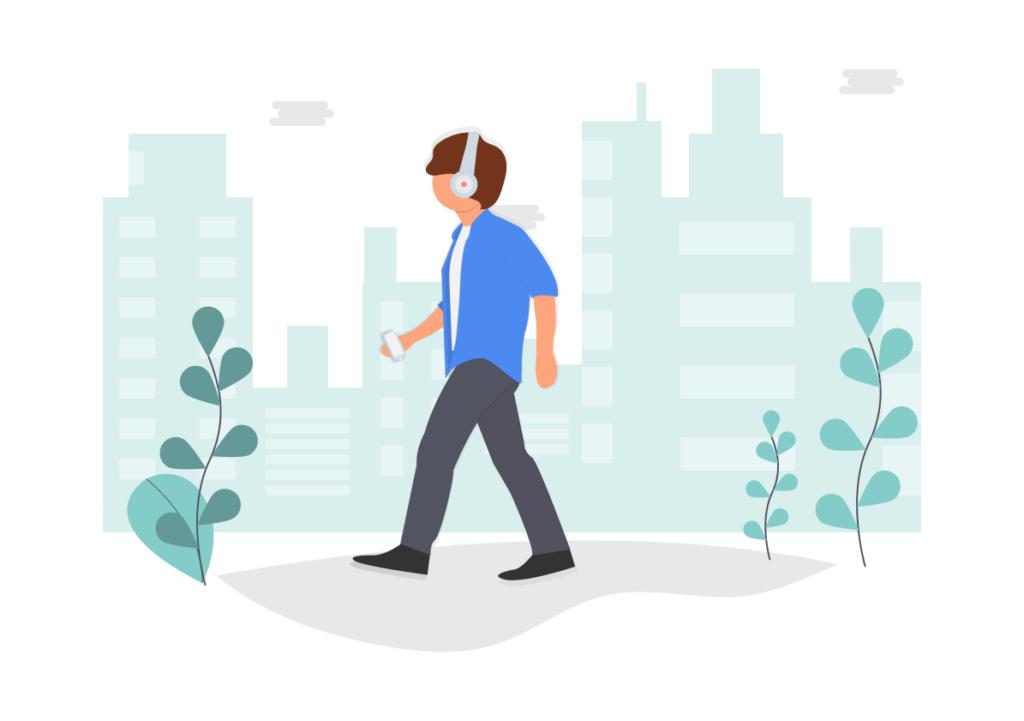 無線のヘッドホンをしながら歩く男性